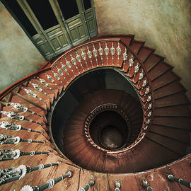 Jaroslaw Blaminsky - Spiral staircase in red and brown tones