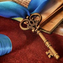 Jaroslaw Blaminsky - Still life with brass ornamented key and blue ribbon