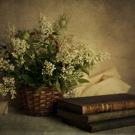 Jaroslaw Blaminsky - Still life with old books and white flowers in the basket