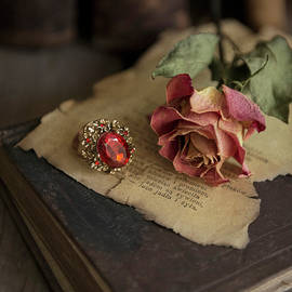 Jaroslaw Blaminsky - Still life with old books, dried rose and big ring