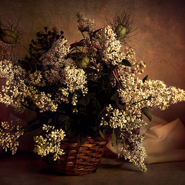 Still life with white flowers in the basket