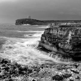 Pedro Cardona - stormy sea - Slow waves in a rocky coast black and white photo