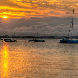 Mike  Deutsch - Sunset Over Clouds And Boats