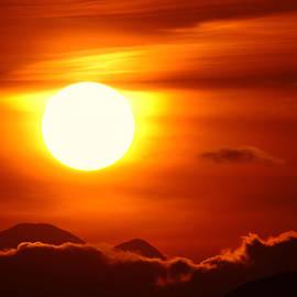 Jeff  Swan - Sunset over Mt Rainer