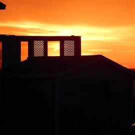 Dan Comeau - Sunset silhouettes balcony