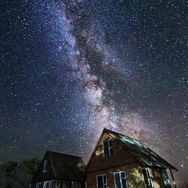 Stanislav Salamanov - The Milky Way that rises among the houses