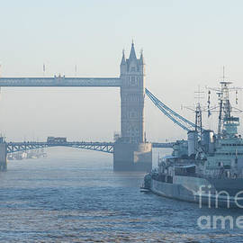 Marcin Rogozinski - Tower Bridge and HMS Belfast on a foggy day in London