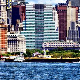 Susan Savad - Tugboat Pushing Barge Near Manhattan Skyline