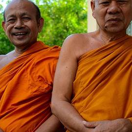Imran Ahmed - Two happy laughing Buddhist monks in robes Hat Yai Thailand