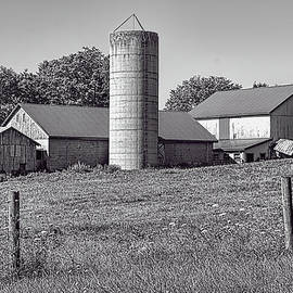 William Sturgell - Two Silos. Two Barns And A Shed in BW