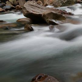 Jeff Swan - Upturned rock in a flowing stream