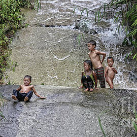 Chuck Kuhn - Vietnamese Children Water slide
