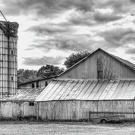 William Sturgell - Weathered Barn and Silo in Black and White