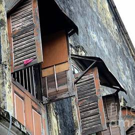 Imran Ahmed - Weathered wooden shutters and windows in old building Georgetown Penang Malaysia