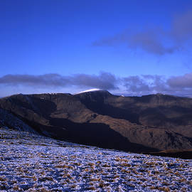 Winter view of Helvellyn from Fairfield Summit above Ambleside Lake District Cumbria England