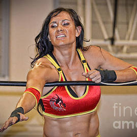 Jim Fitzpatrick - Wrestling Beauty Kahmora Reaching Out To Tag Her Partner