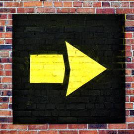 Nikolyn McDonald - Yellow arrow - Right - Brick Wall