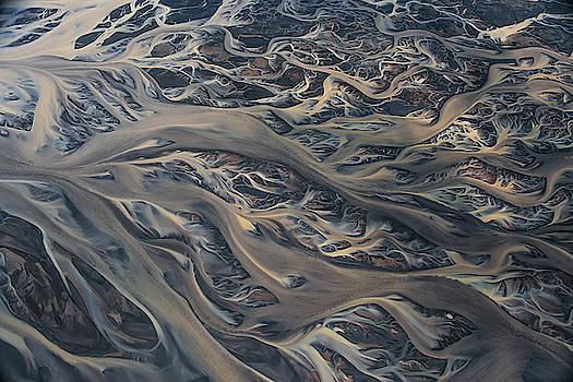 An Aerial View Of Streams Of Glacier by Keith Ladzinski