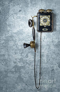 Antique Telephone On A Grungy Blue Wall by Palatia Photo
