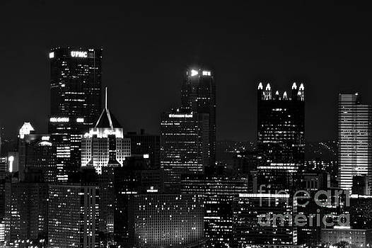 Black and White Buildings at Night by Jay Nodianos