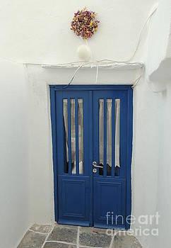 Blue door by Paraskevas Momos