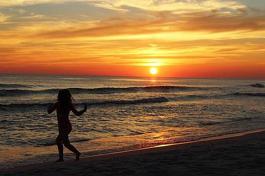 Child Running on Beach at Sunset by Vicki Kennedy