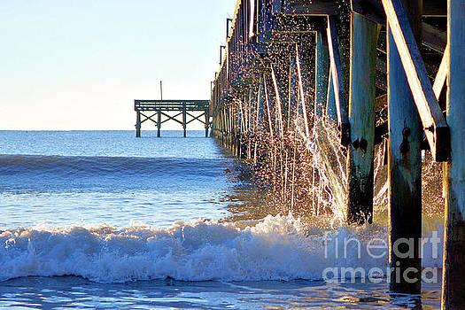 Crashing Waves At Pier by Dawne Dunton