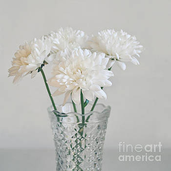 Creamy white flowers in tall vase by Lyn Randle