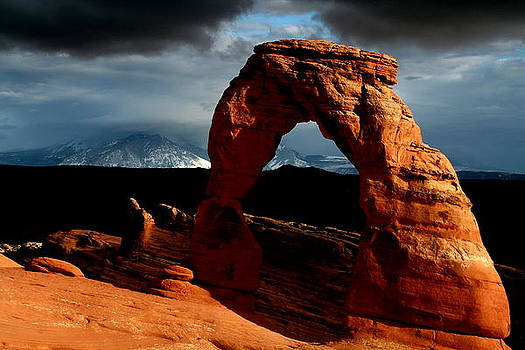 Incoming storm at Delicate Arch at Arches National Park by Jetson Nguyen