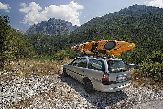 Kayak and car in the mountain by Peter Til