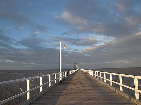 Pier and shadows by Elizabeth Hardie