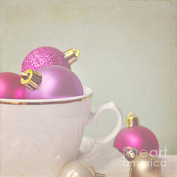 Pink and gold Christmas baubles in china cup. by Lyn Randle