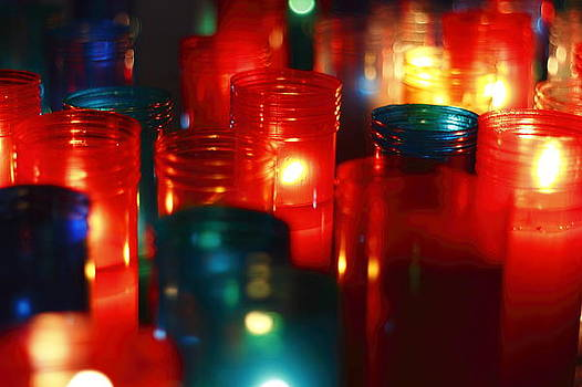 Red and blue candle lights by Guillermo Bardavio