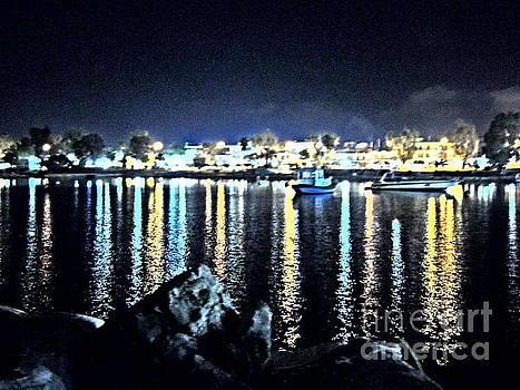 Seaside city by the night lights by Paraskevas Momos