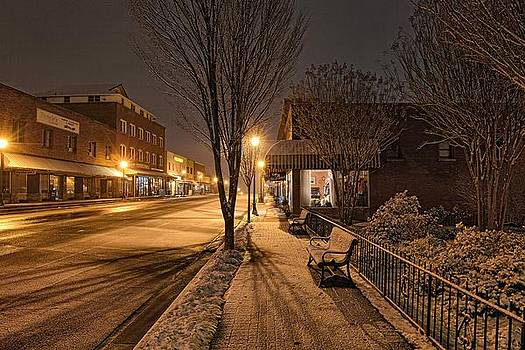 Snowy Delight in the Main Street Lights 02 by Eric Haggart