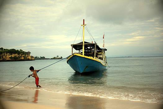 A Child Fisherman by Yusron Rohim