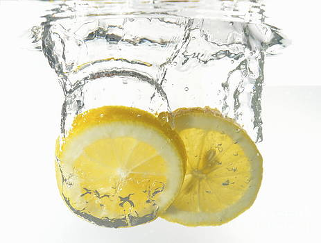 Lemon slices underwater by Sami Sarkis