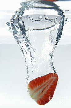 Strawberry fruit splashing underwater by Sami Sarkis