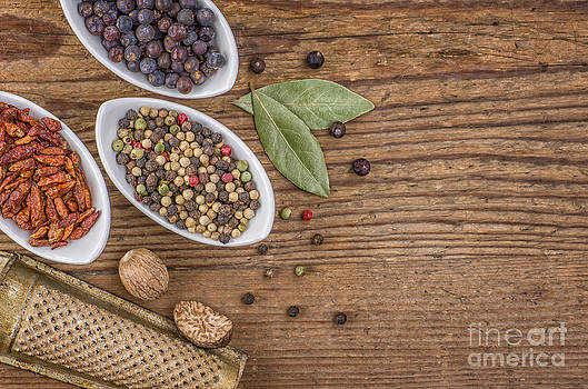 Various spices on a wooden background by Palatia Photo