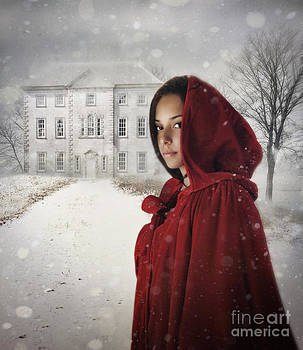 Sandra Cunningham - Young woman wearing hooded cape in snowy winter scene