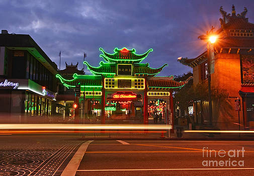 Jamie Pham - Entrance to Los Angeles Chinatown at night with neon lights.