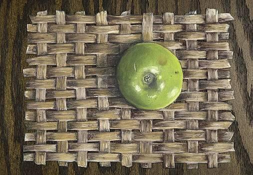 Green Apple on basket by Claude Schneider