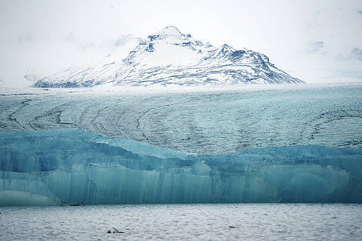 Icebergs In Jokulsarlon Glacier Lagoon by Raul Touzon