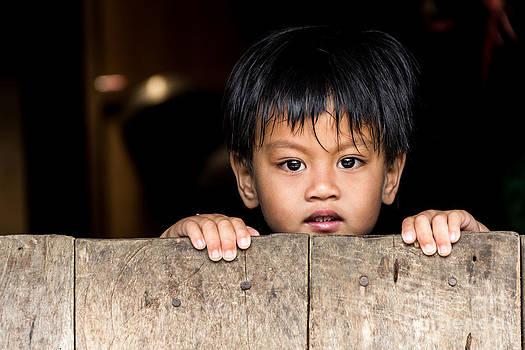 A child behind half door  by Frederiko Ratu Kedang