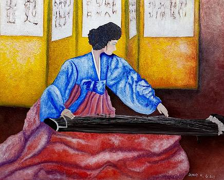 A lady playing a Gayageum by Sunny  Kim