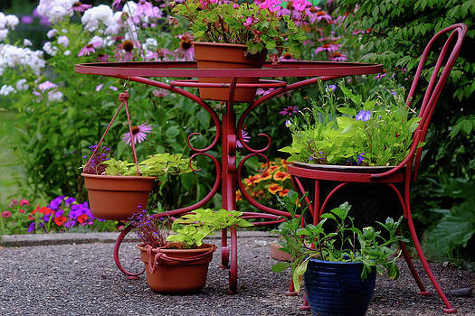 A Red Wrought Iron Plant Stand by Paul Damien