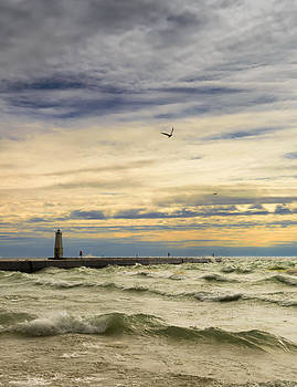 A stormy late afternoon Frankfort Harbor Michigan by Dick Wood
