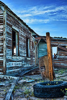 abandoned blue house in Mojave National preserve by Kim M Smith