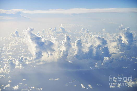Above cloudscape over ocean by Sami Sarkis