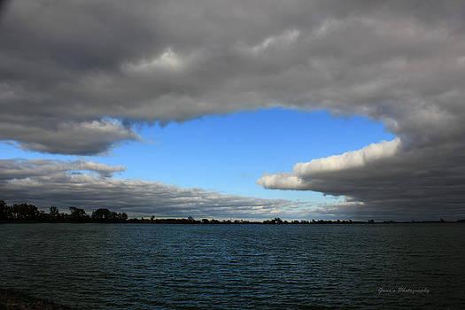 An Island Of Blue In A Sea Of Gray by Robert Geier